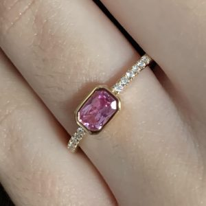 Pink sapphire ring on hand