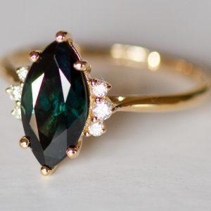 Teal peacock green marquise sapphire and diamond ring