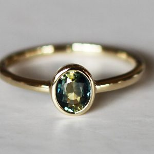 Oval teal petite sapphire gold ring